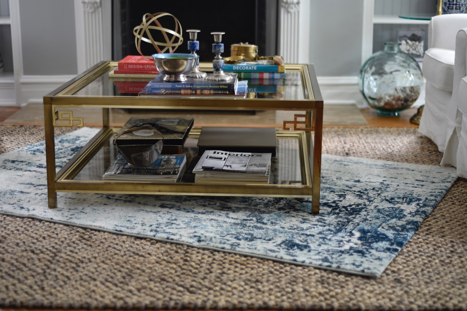 Layering rugs in the living room www.homewithkeki.com