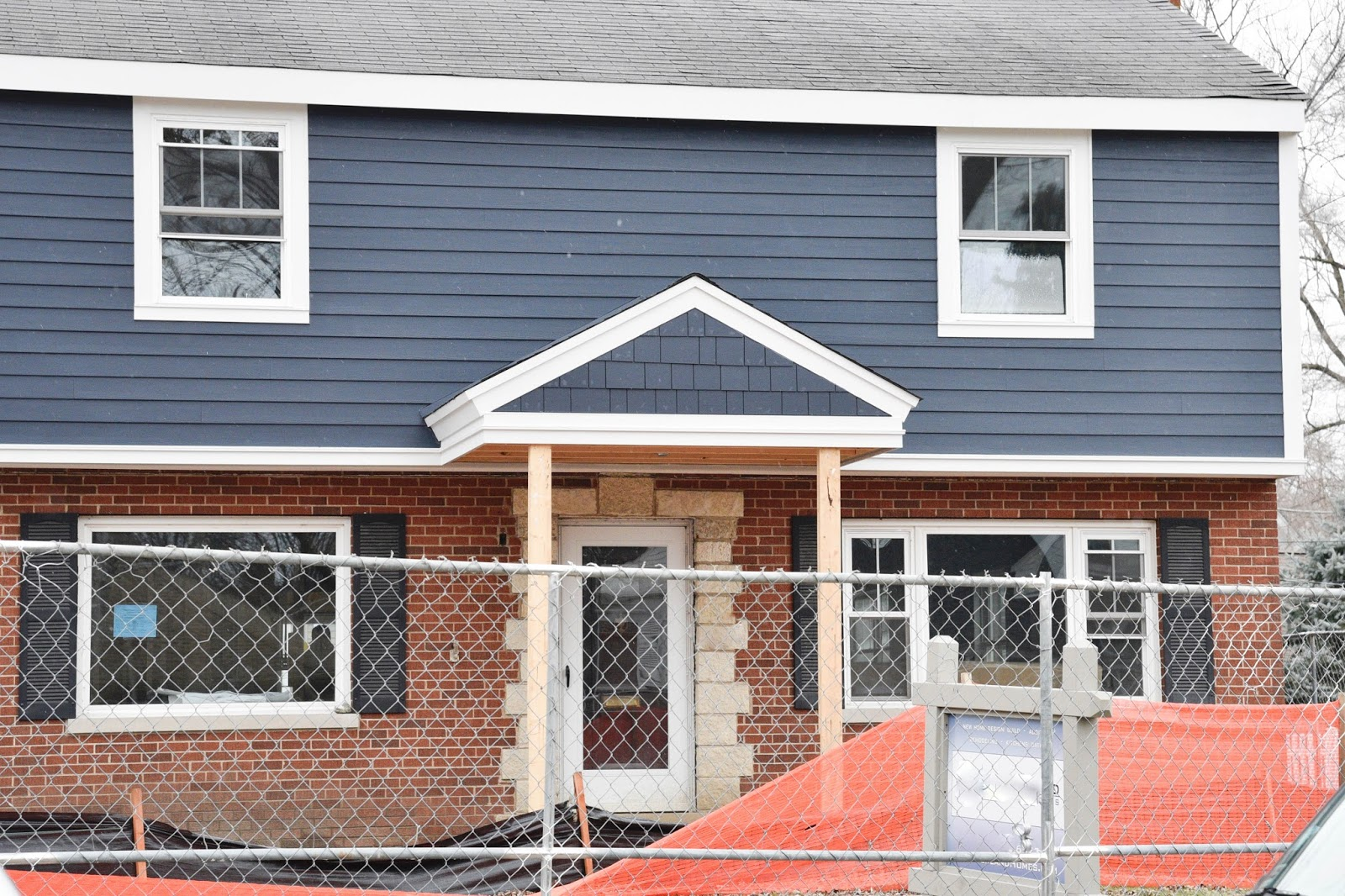 Picking blue exterior siding with a red brick home home for Brick looking siding