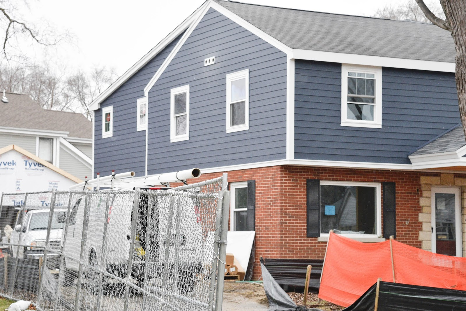 Picking Blue Exterior Siding With A Red Brick Home Keki